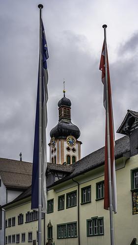 Banners of Fischingen and Switzerland in front of Fischingen Kloster, Fischingen, Canton of Thurgau, Switzerland
