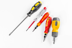 Set of different screwdrivers on a white background
