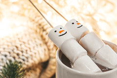 Christmas background with coffee and marshmallow snowmen
