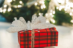 Gift red box on christmas background