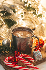 Christmas evening background with hot cocoa and glowing garland