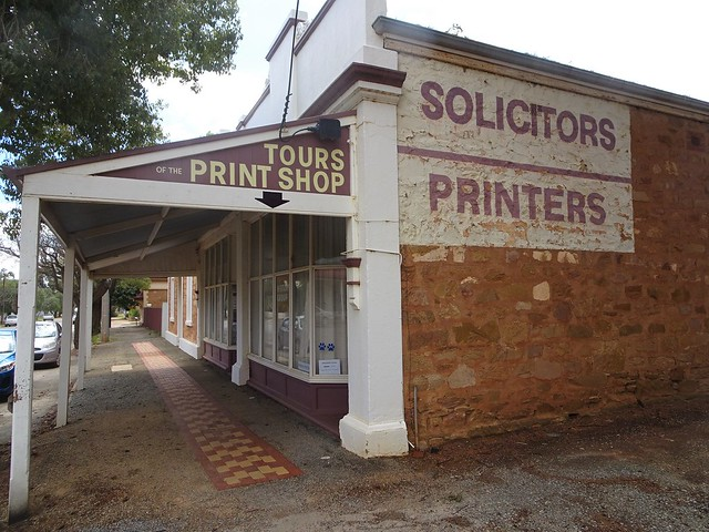Photo:Peterborough. South Australia. Old newspaper pritners office and wall advertismenet for solicitors. By denisbin