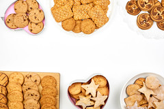 Overhead view of different cookies set on white