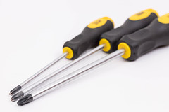 Screwdrivers above white background
