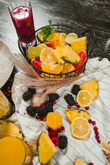 Mix Of Citrus Fruit Bowl And Blackberry Smoothie