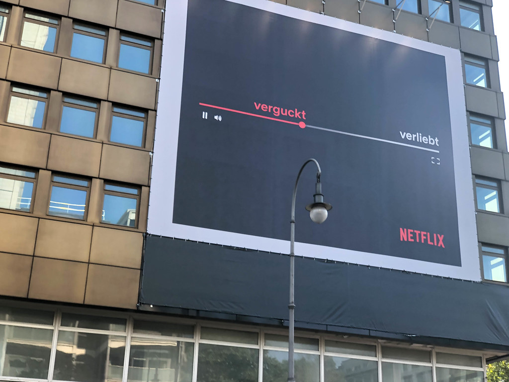 Huge Netflix advertisement on the facade of the huge empty building at Friesenplatz in Cologne