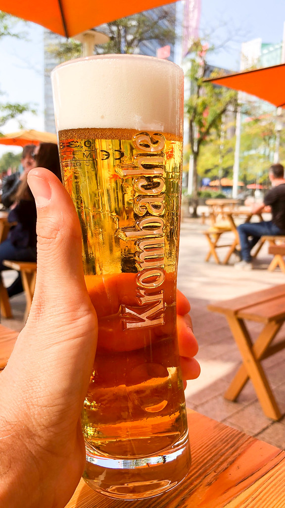 Cheers! A Krombacher draft beer on a sunny day at the Media Park in Cologne