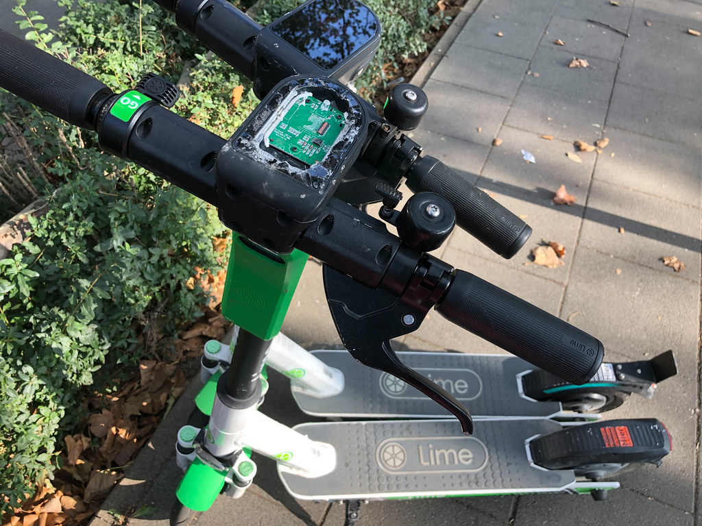 Vandalism: one of two Lime electric scooters with destroyed display on the street in Cologne