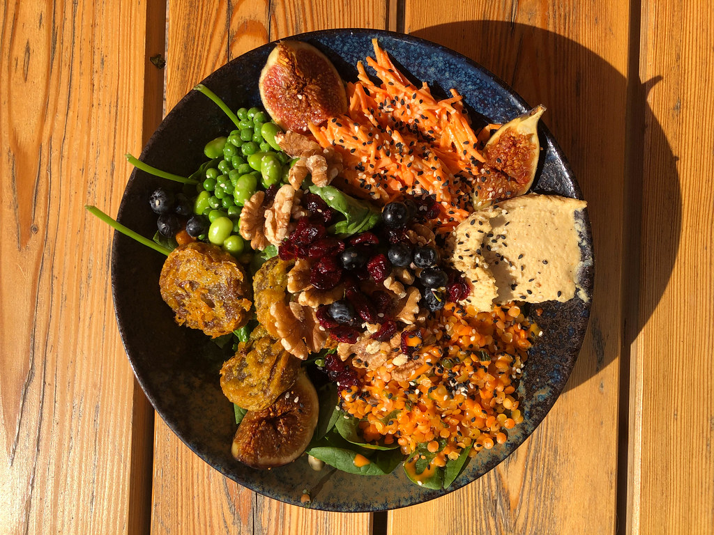 Top view of vegan bowl with figs on wooden background at Good Food Bar & Restaurant, Cologne