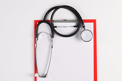 Stethoscope and Clipboard with white paper