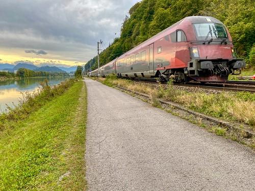 ÖBB railjet express train passing the river Inn between Kufstein, Austria and Kiefersfelden, Germany