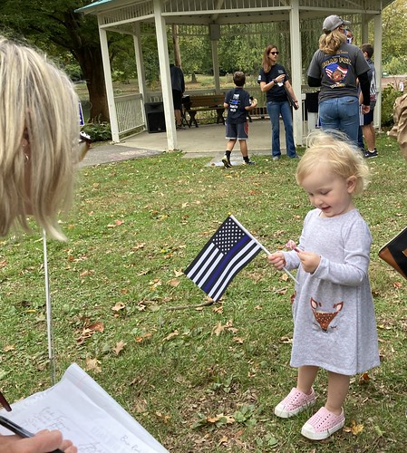 A little girl with a back the blue flag at Springfield Township rally