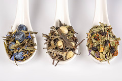 Assortment of fruit green dry teas in spoons, top view