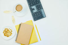 Designer workspace on desk table essential elements on flat lay