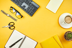 Stylish yellow workspace with office supplies