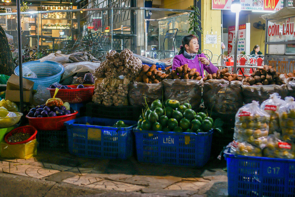 Vendor selling many kinds of Fruits and Vegetables at a Street Market in Dalat, Vietnam