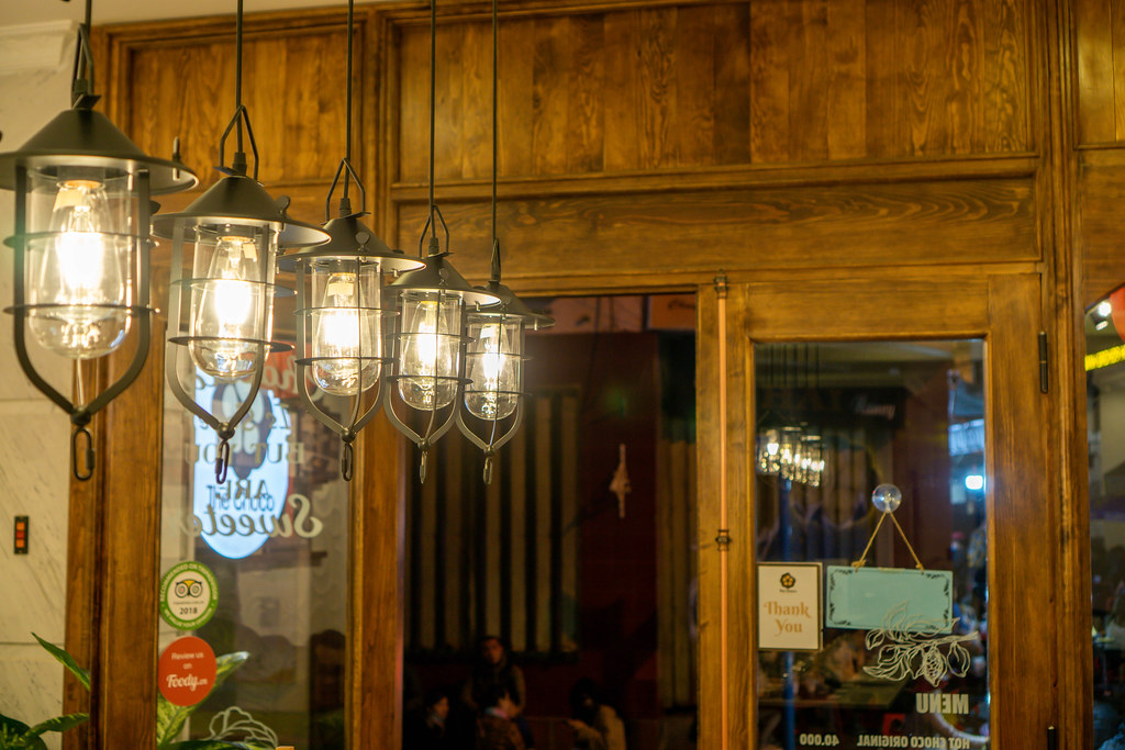 Decorative Hanging Lights with Light Bulbs inside a Cafe iwith Wooden Design