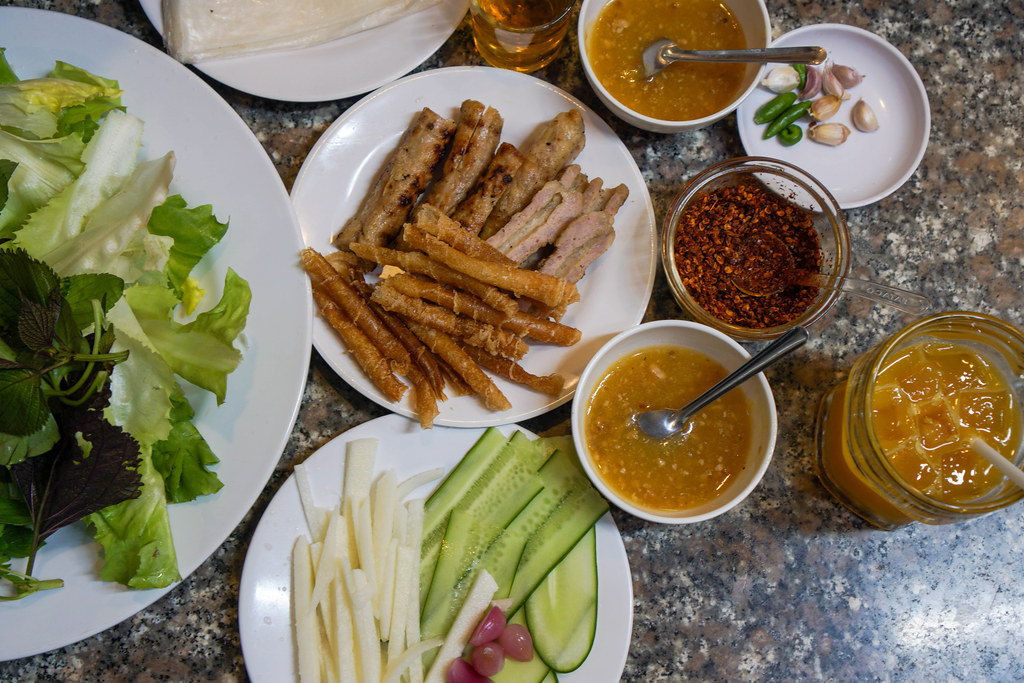 Vietnamese Grilled Pork Sausauge with different kinds of Herbs, Vegetables and Rice Paper