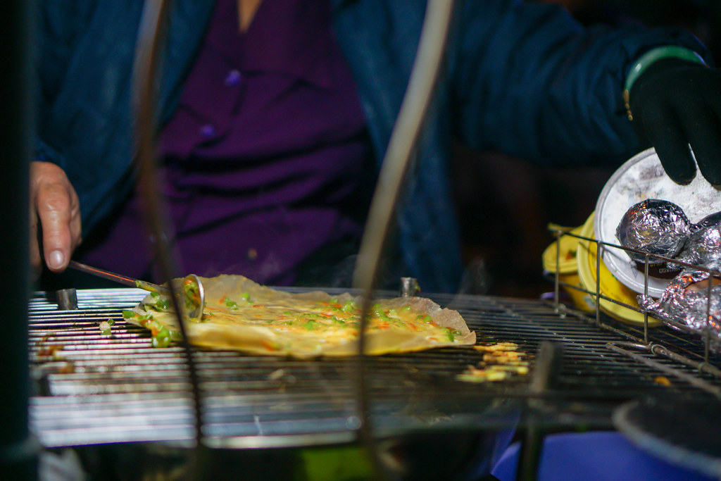 Close Up Photo of a Woman making Vietnamese Grilled Rice Paper
