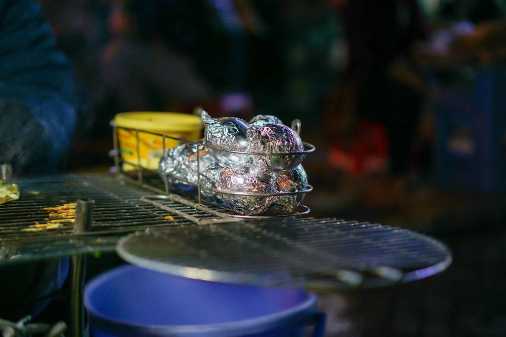 Grilled Eggs wrapped in Aluminium Foil on a Barbecue Grill