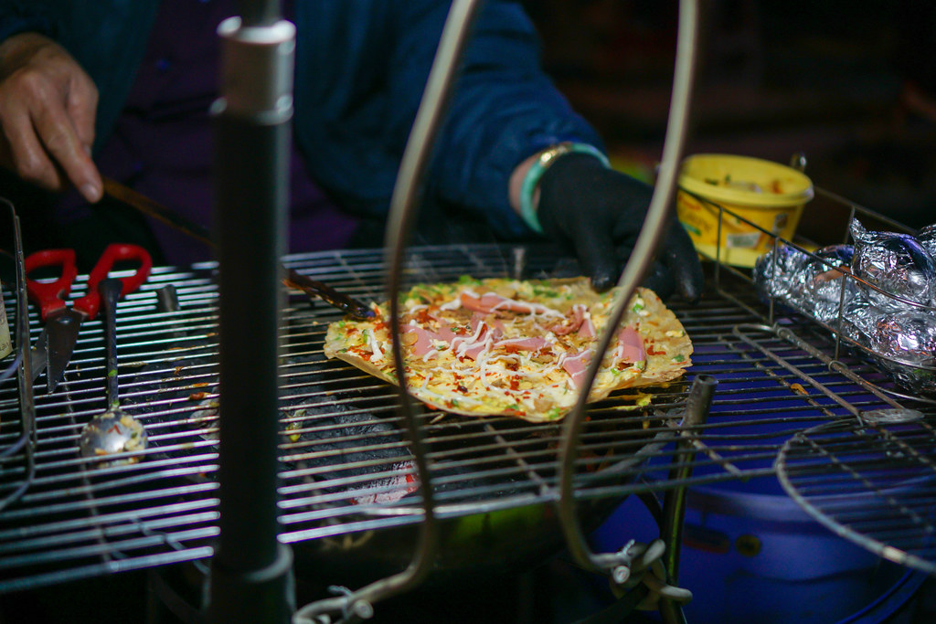 Bokeh Photo of Vietnamese Banh Trang Nuong on a Barbecue Grill