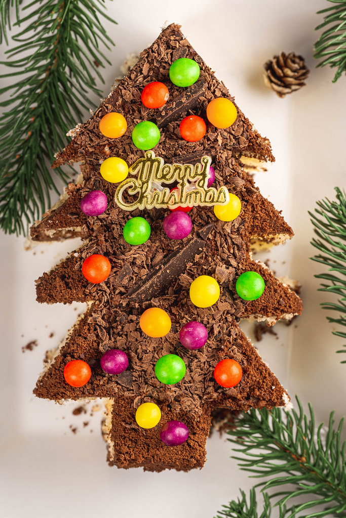 Top view, chocolate cake with colorful candies. Christmas dessert