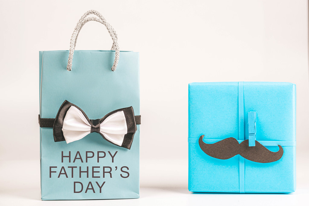 Blue gifts with male attributes - happy father's day concept