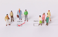 Yes and No check boxes with red check mark in the Yes box. The concept of gender discrimination in society.