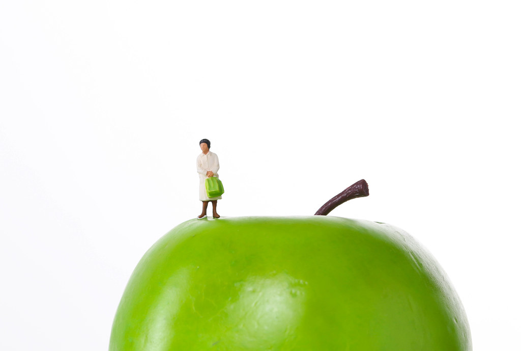 Woman standing on a green apple