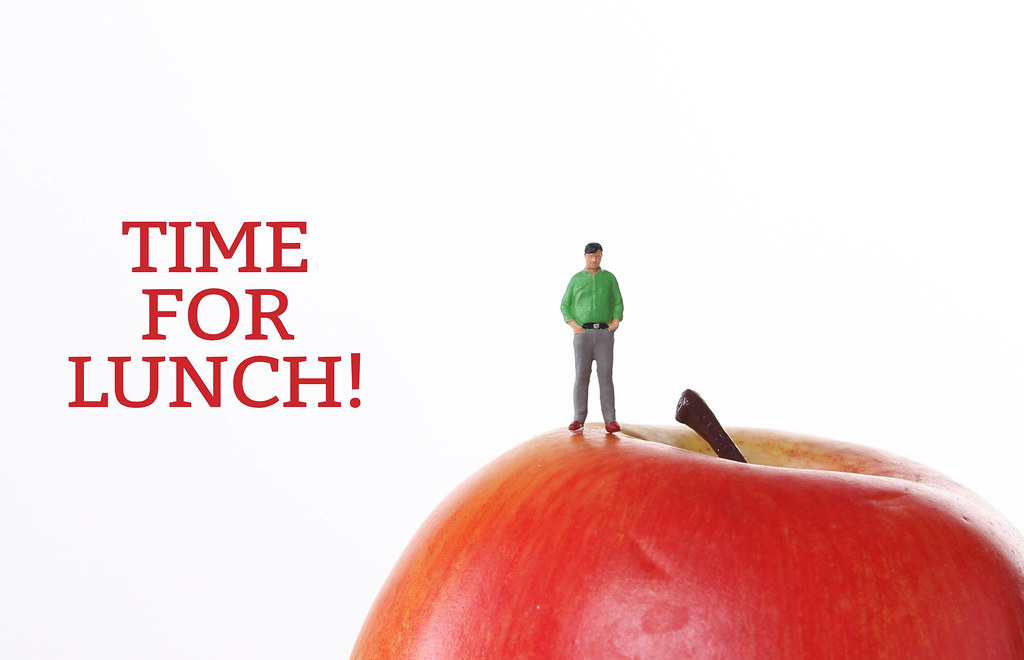 Man with red apple and Time For Lunch text