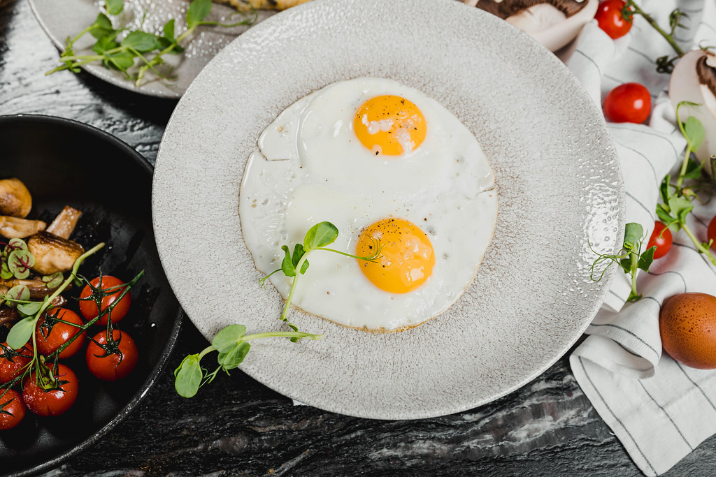 Two Eggs With Tomatoes Background Food Photography