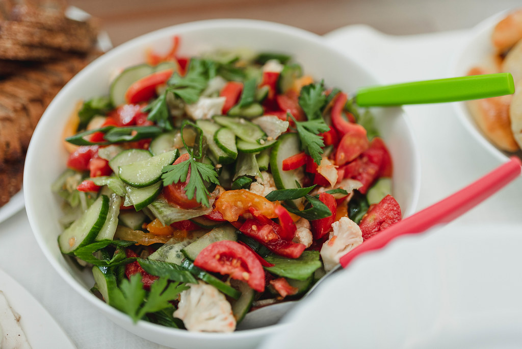 Tomato And Cucumber Salad In Bowl