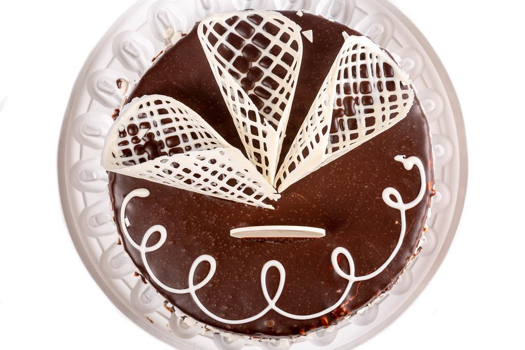 Top view, birthday chocolate cake with white chocolate decor