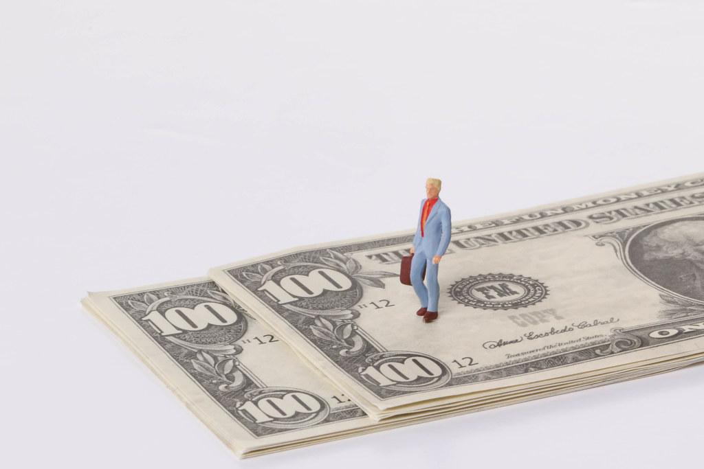 Man stadning on a dollar bank notes