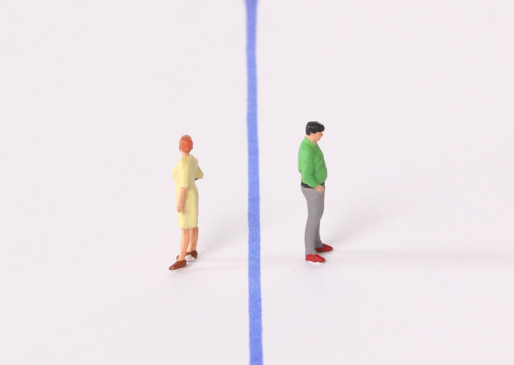 Man and woman with blue line between them
