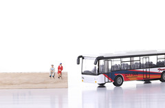 Older man and women with city bus