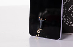 Man cleaning smartphone screen
