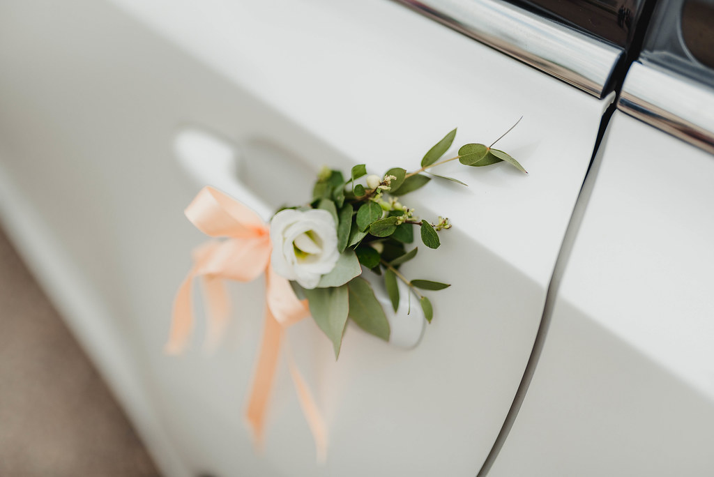 Wedding Car Decorated With White Rose