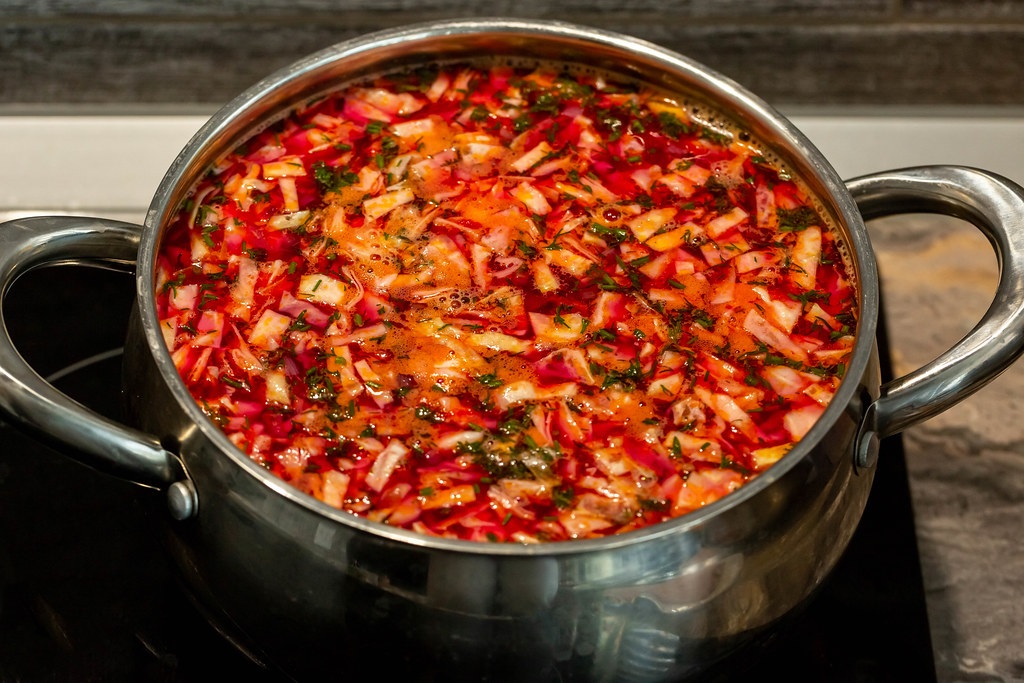 Pan with prepared borscht on a stove