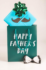 Happy father's day text on green gift package