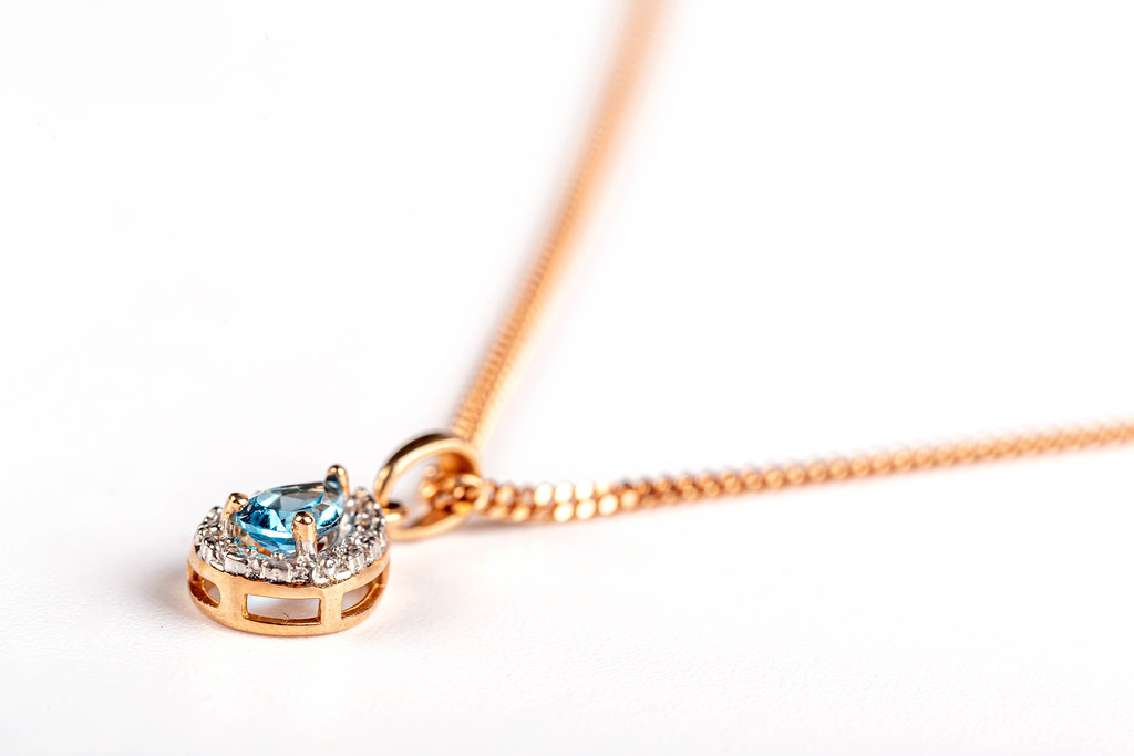 Close-up, gold pendant with topaz stone and chain