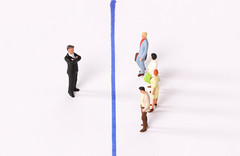 Businessman and group of people with blue line between them