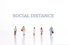 Group of people and Social Distance text
