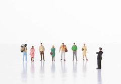 Businessman and group of people on white background