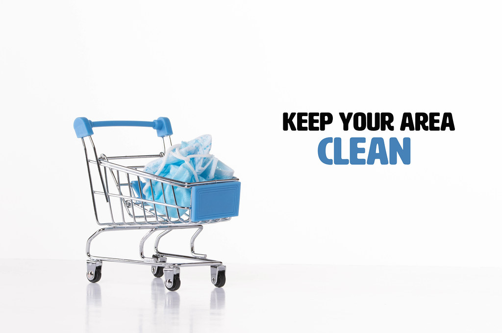 Shopping cart with used medical face mask and Keep your are clean text