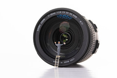 Man cleaning camera lens