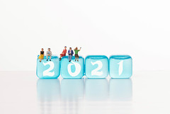 Group of people with blue ice cubes and 2021 text