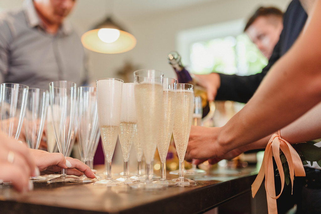 Filling Up Champagne Glases On Wedding Table