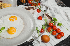 Breakfast Eggs With Tomatoes And White Towel