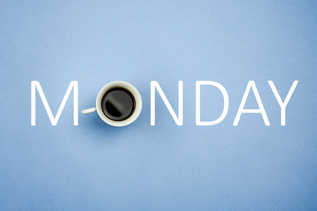 Coffee forming monday text on bright blue background